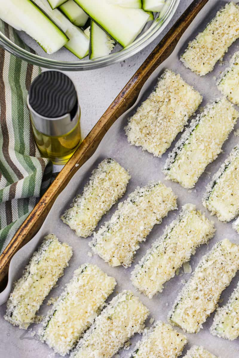 coated Baked Zucchini Sticks on a baking sheet before cooking