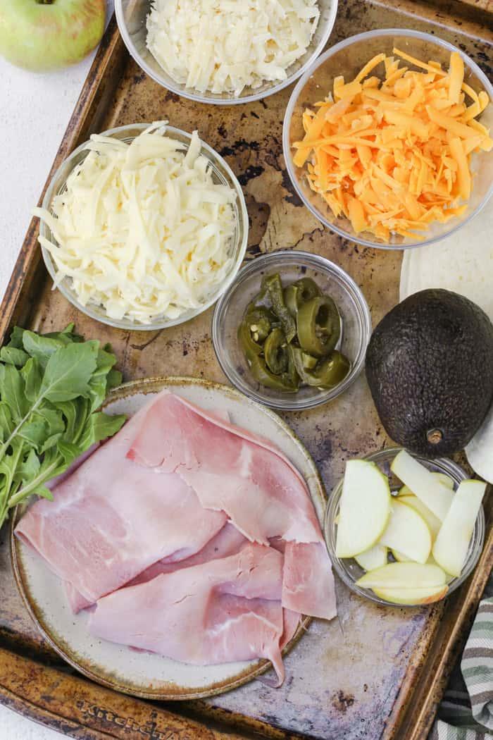Ingredients assembled on a baking sheet ready to make quesadillas
