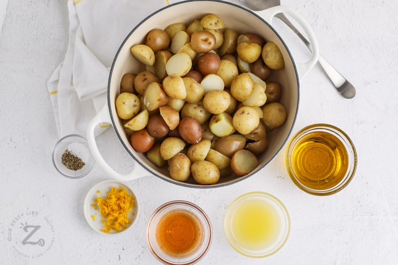 potatoes in a pot and seasonings in bowls to make Vinaigrette Potato Salad