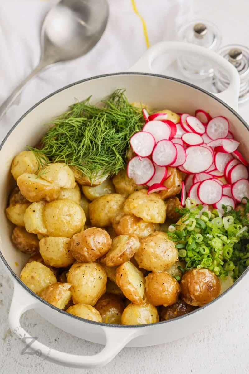 ingredients in the pot before mixing to make Vinaigrette Potato Salad
