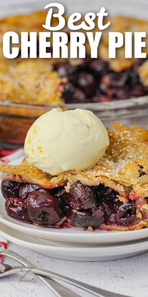 plated Cherry Pie with ice cream and pie in the back with writing