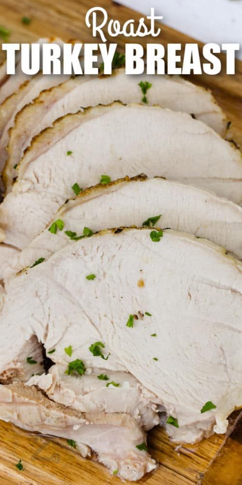 slices of Roast Turkey Breast on a board with writing