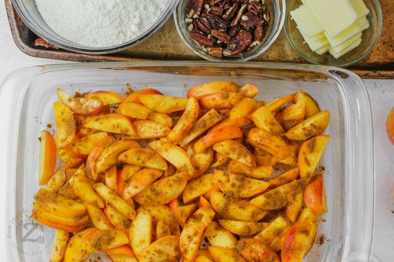 adding ingredients to casserole dish to make Peach Dump Cake