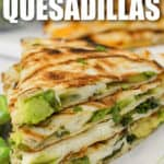 veggie quesadillas on a plate with writing