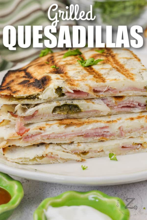 ham and cheese Grilled Quesadillas on a plate with a title