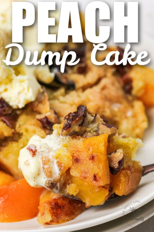 plated Peach Dump Cake with a spoon full and writing