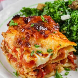 Skillet Lasagna on a plate with kale salad