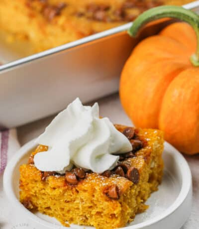 plated Easy Pumpkin Bars with whipped cream on top